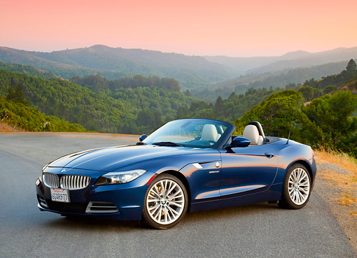 AUT 01 BK0002 01 © Kimball Stock 2009 BMW Z4 Convertible Blue 3/4 Front View On Pavement By Hills
