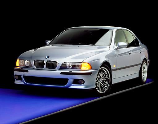 AUT 01 RK0092 02 © Kimball Stock 2000 BMW M5 Light Blue 3/4 Front View On Purple Floor Gray Line Studio
