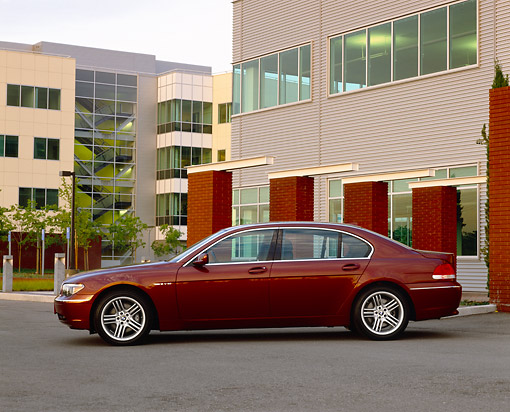 AUT 01 RK0169 01 © Kimball Stock 2003 BMW 760Li Red Profile View By Buildings