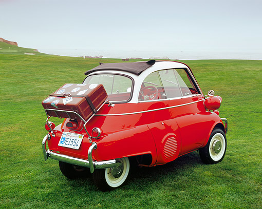 AUT 01 RK0223 01 © Kimball Stock 1958 BMW Isetta Red And White 3/4 Rear View On Grass Filtered