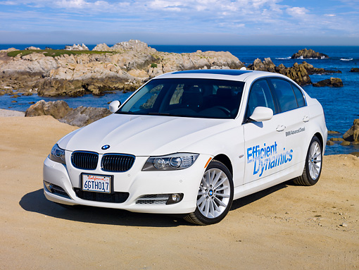 AUT 01 RK0342 01 © Kimball Stock 2009 BMW 335d White 3/4 Front View By Ocean