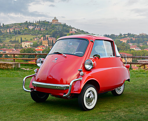 AUT 01 RK0360 01 © Kimball Stock 1957 BMW Isetta Convertible Red 3/4 Front View On Grass By Hills