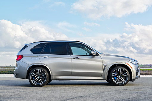 AUT 01 RK0362 01 © Kimball Stock 2015 BMW X5 M Silver Profile View On Pavement Under Clouds
