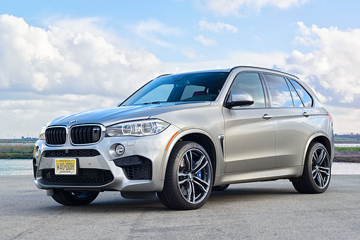 AUT 01 RK0363 01 © Kimball Stock 2015 BMW X5 M Silver 3/4 Front View On Pavement Under Clouds