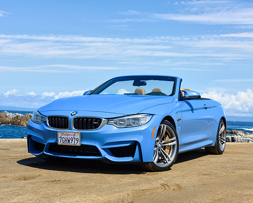 AUT 01 RK0367 01 © Kimball Stock 2015 BMW M4 Blue 3/4 Front View By Beach