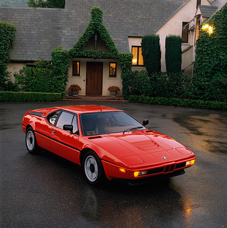 AUT 01 RK0003 03 © Kimball Stock 1988 BMW M1 Red 3/4 Front View On Wet Pavement By House