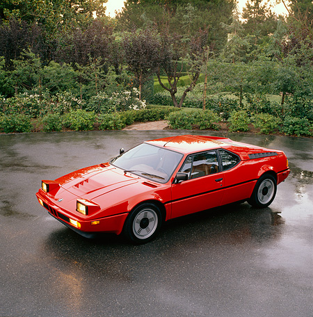 AUT 01 RK0009 08 © Kimball Stock 1988 BMW M1 Red Overhead Side 3/4 View On Wet Pavement By Trees