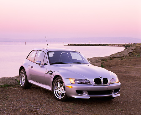 AUT 01 RK0069 04 © Kimball Stock 1999 BMW M Coupe Roadster Silver 3/4 Front View On Dirt By Water Filtered