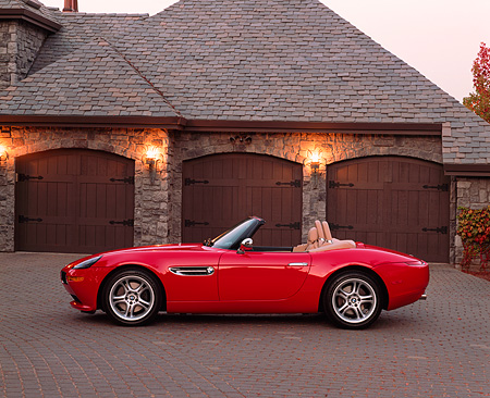 AUT 01 RK0124 05 © Kimball Stock 2001 BMW Z8 Convertible Red Profile View On Driveway In Front Of Garage
