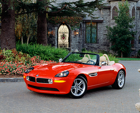 AUT 01 RK0129 01 © Kimball Stock 2001 BMW Z8 Convertible Red Front 3/4 View On Driveway By House And Flowers