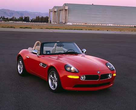 AUT 01 RK0143 02 © Kimball Stock 2001 BMW Z8 Convertible Red Front 3/4 View On Pavement By Hangar