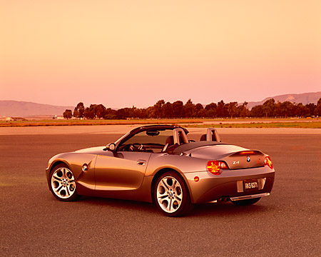 AUT 01 RK0160 05 © Kimball Stock 2003 BMW Z4 3.0i Convertible Gray 3/4 Rear View On Pavement