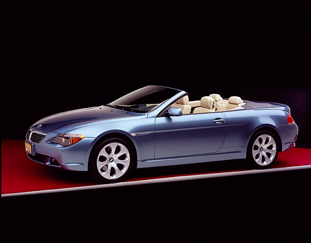 AUT 01 RK0217 02 © Kimball Stock 2005 BMW 645Ci Convertible Blue 3/4 Side View On Red Floor Gray Line Studio