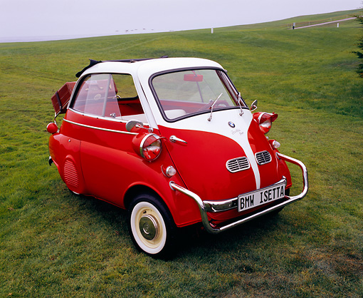 AUT 01 RK0218 02 © Kimball Stock 1958 BMW Isetta Red And White 3/4 Front View On Grass
