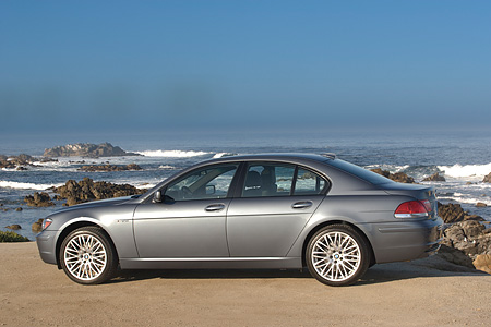 AUT 01 RK0236 01 © Kimball Stock 2006 BMW 760i Gray Profile View On Gravel By Ocean And Rocks