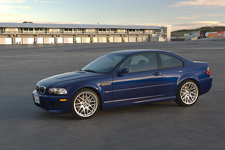 AUT 01 RK0250 01 © Kimball Stock 2006 BMW M3 Competition Package Blue 3/4 Side View On Pavement