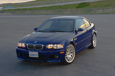 AUT 01 RK0251 01 © Kimball Stock 2006 BMW M3 Competition Package Blue 3/4 Front View On Pavement