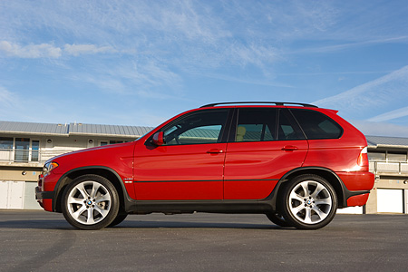 AUT 01 RK0252 01 © Kimball Stock 2006 BMW X5 Red Low Profile Shot On Pavement