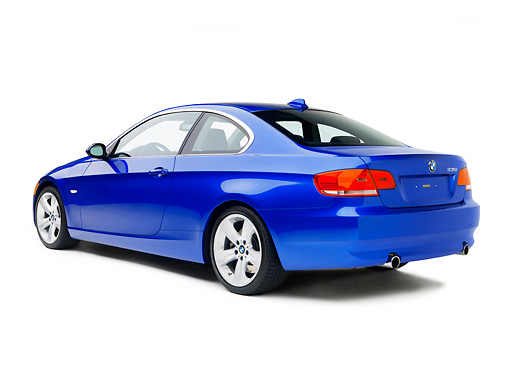 AUT 01 RK0282 01 © Kimball Stock 2007 BMW 335i Coupe Blue 3/4 Rear View On White Seamless Studio