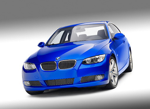 AUT 01 RK0284 01 © Kimball Stock 2007 BMW 335i Coupe Blue 3/4 Front View On White Seamless Studio