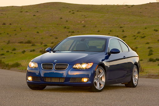 AUT 01 RK0287 01 © Kimball Stock 2007 BMW 335i Coupe Blue 3/4 Front View On Pavement By Hills