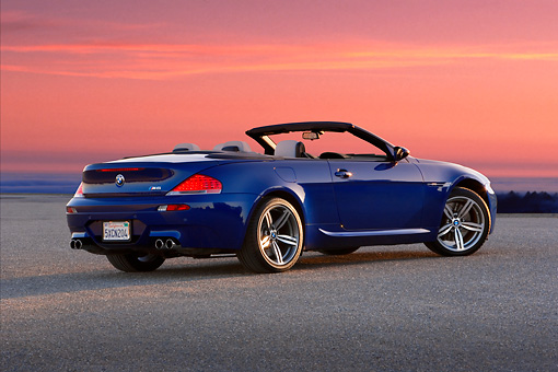 AUT 01 RK0291 01 © Kimball Stock 2007 BMW M6 Convertible Blue 3/4 Rear View On Pavement By Grass Hills
