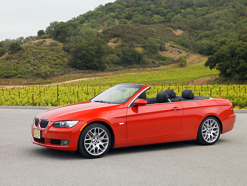 AUT 01 RK0297 01 © Kimball Stock 2007 BMW 328Ci Convertible Red 3/4 Side View On Pavement