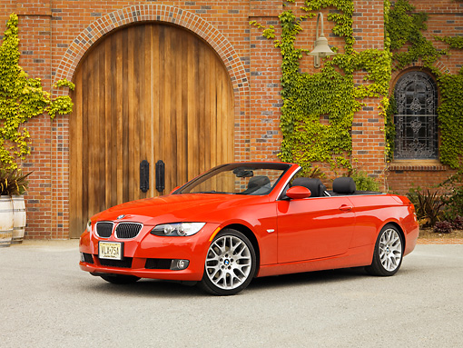 AUT 01 RK0298 01 © Kimball Stock 2007 BMW 328Ci Convertible Red Low 3/4 Side View On Pavement