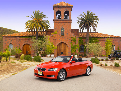 AUT 01 RK0299 01 © Kimball Stock 2007 BMW 328Ci Convertible Red 3/4 Front View On Pavement