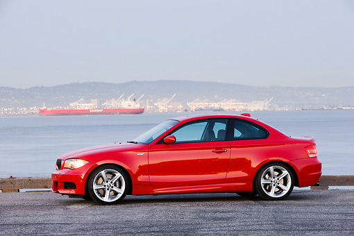 AUT 01 RK0321 01 © Kimball Stock 2008 BMW 135i Red 3/4 Front View By Harbor