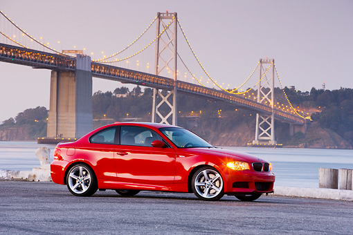 AUT 01 RK0325 01 © Kimball Stock 2008 BMW 135i Red 3/4 Front View By Bridge