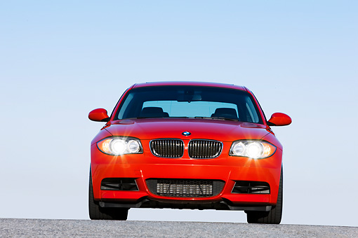 AUT 01 RK0329 01 © Kimball Stock 2008 BMW 135i Red Head On View Blue Sky