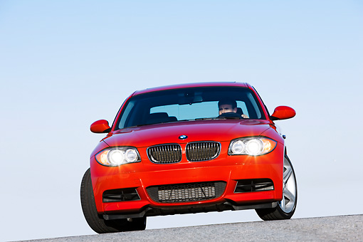 AUT 01 RK0330 01 © Kimball Stock 2008 BMW 135i Red Head On View Blue Sky