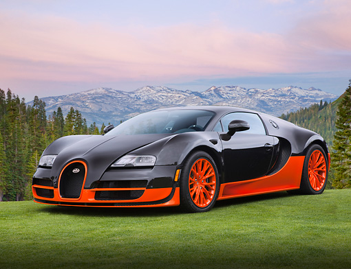 AUT 02 BK0001 01 © Kimball Stock 2012 Bugatti Veyron SS Black And Orange 3/4 Front View On Grass By Snowy Mountains