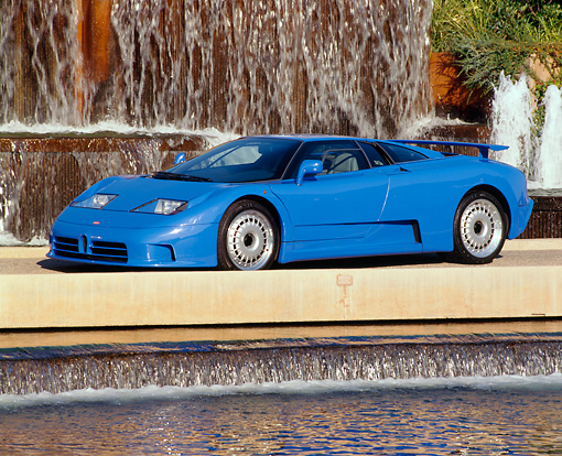 AUT 02 RK0008 01 © Kimball Stock 1994 Bugatti EB110 GT Coupe Blue 3/4 Side View By Water Fountain
