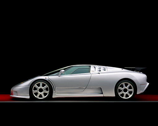 AUT 02 RK0066 08 © Kimball Stock 1994 Bugatti EB110 SS Silver Profile On Gray Line Red Floor Studio