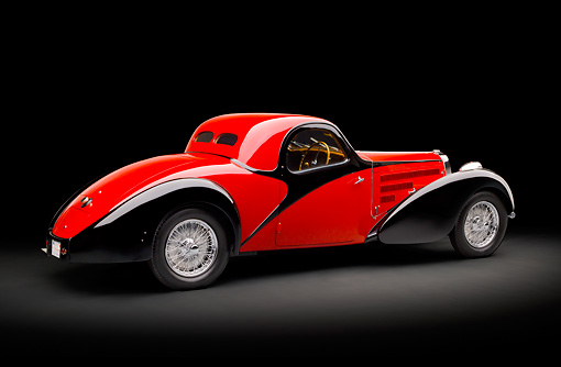 AUT 02 RK0132 01 © Kimball Stock 1937 Bugatti Type 57 S Atalante Coupe Red And Black 3/4 Rear View In Studio