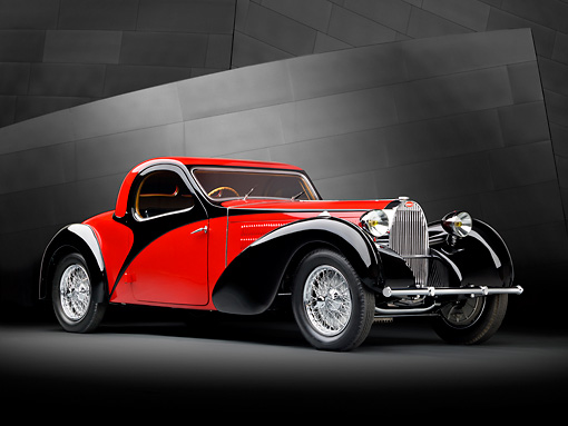 AUT 02 RK0144 01 © Kimball Stock 1937 Bugatti Type 57 S Atalante Coupe Red And Black 3/4 Front View In Studio By Metal Wall