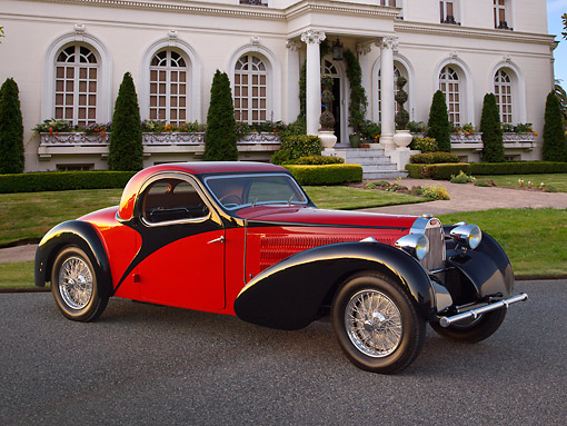 AUT 02 RK0147 01 © Kimball Stock 1937 Bugatti Type 57 S Atalante Coupe Red And Black 3/4 Side View On Pavement By Mansion