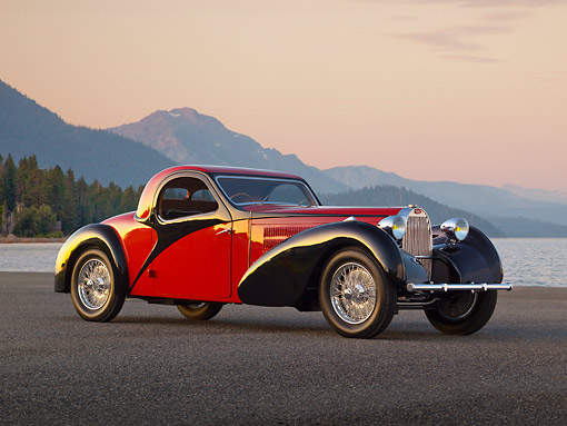 AUT 02 RK0148 01 © Kimball Stock 1937 Bugatti Type 57 S Atalante Coupe Red And Black 3/4 Side View On Pavement By Lake At Dusk