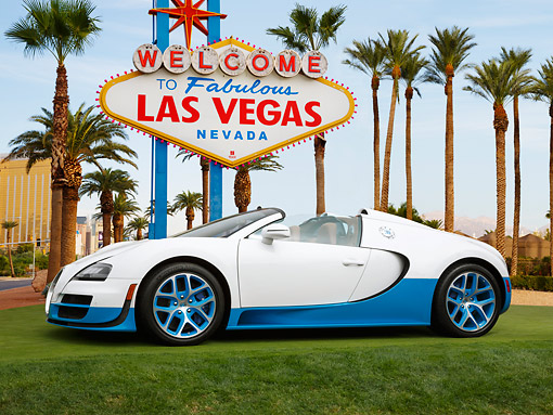 AUT 02 RK0151 01 © Kimball Stock Bugatti Veyron 16.4 Grand Sport Vitesse SE White And Blue Profile View On Grass By Las Vegas Sign