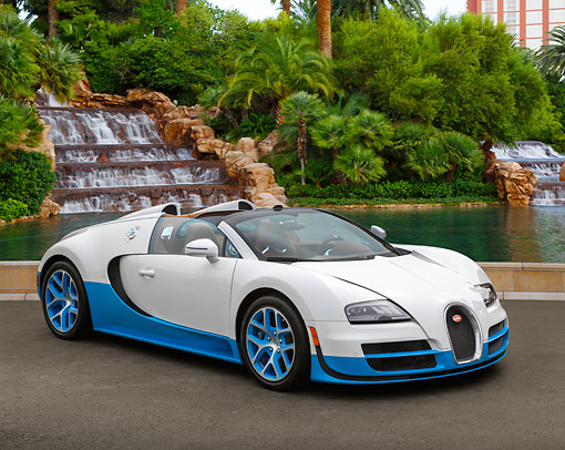 AUT 02 RK0152 01 © Kimball Stock Bugatti Veyron 16.4 Grand Sport Vitesse SE White And Blue 3/4 Front View On Pavement By Waterfall
