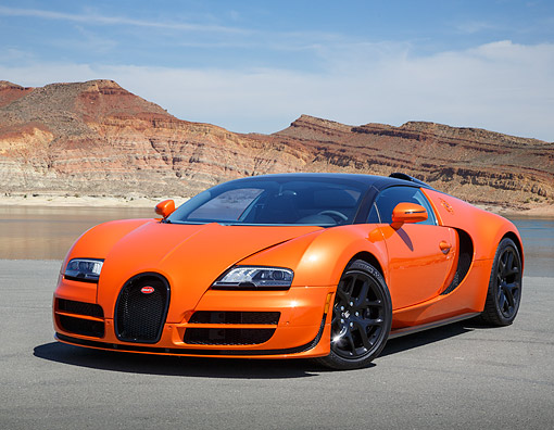 AUT 02 RK0154 01 © Kimball Stock 2013 Bugatti Veyron 16.4 Grand Sport Vitesse Orange 3/4 Front View On Pavement In Desert