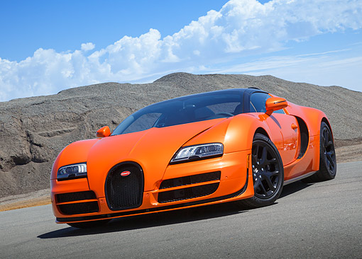 AUT 02 RK0155 01 © Kimball Stock 2013 Bugatti Veyron 16.4 Grand Sport Vitesse Orange 3/4 Front View On Pavement In Desert