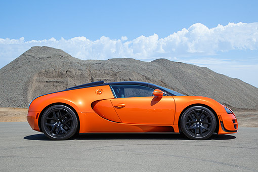 AUT 02 RK0156 01 © Kimball Stock 2013 Bugatti Veyron 16.4 Grand Sport Vitesse Orange Profile View On Pavement In Desert