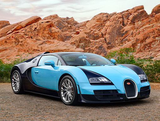 AUT 02 RK0158 01 © Kimball Stock 2013 Bugatti Veyron Grand Sport Blue 3/4 Front View On Pavement In Desert