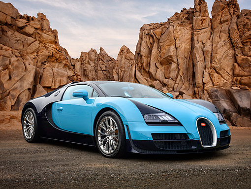 AUT 02 RK0159 01 © Kimball Stock 2013 Bugatti Veyron Grand Sport Vitesse Blue 3/4 Front View On Pavement In Desert