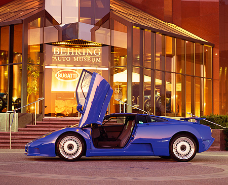AUT 02 RK0005 03 © Kimball Stock 1994 Bugatti EB110 GT Coupe Blue Profile Shot Doors Open By Museum At Dusk