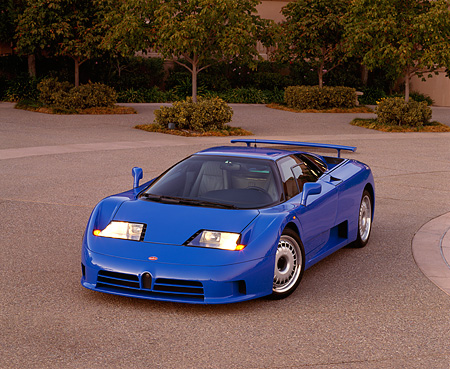 AUT 02 RK0015 05 © Kimball Stock 1994 Bugatti EB110 GT Coupe Blue 3/4 Front View On Pavement