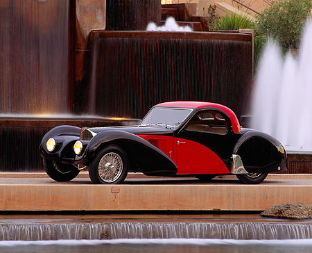 AUT 02 RK0018 04 © Kimball Stock 1937 Bugatti Atalante 57SC Coupe Red And Black 3/4 Side View By Water Fountain